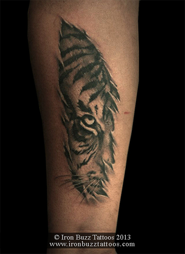 Skin tear effect and Tiger tattoo