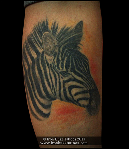 Zebra animal tattoo on leg