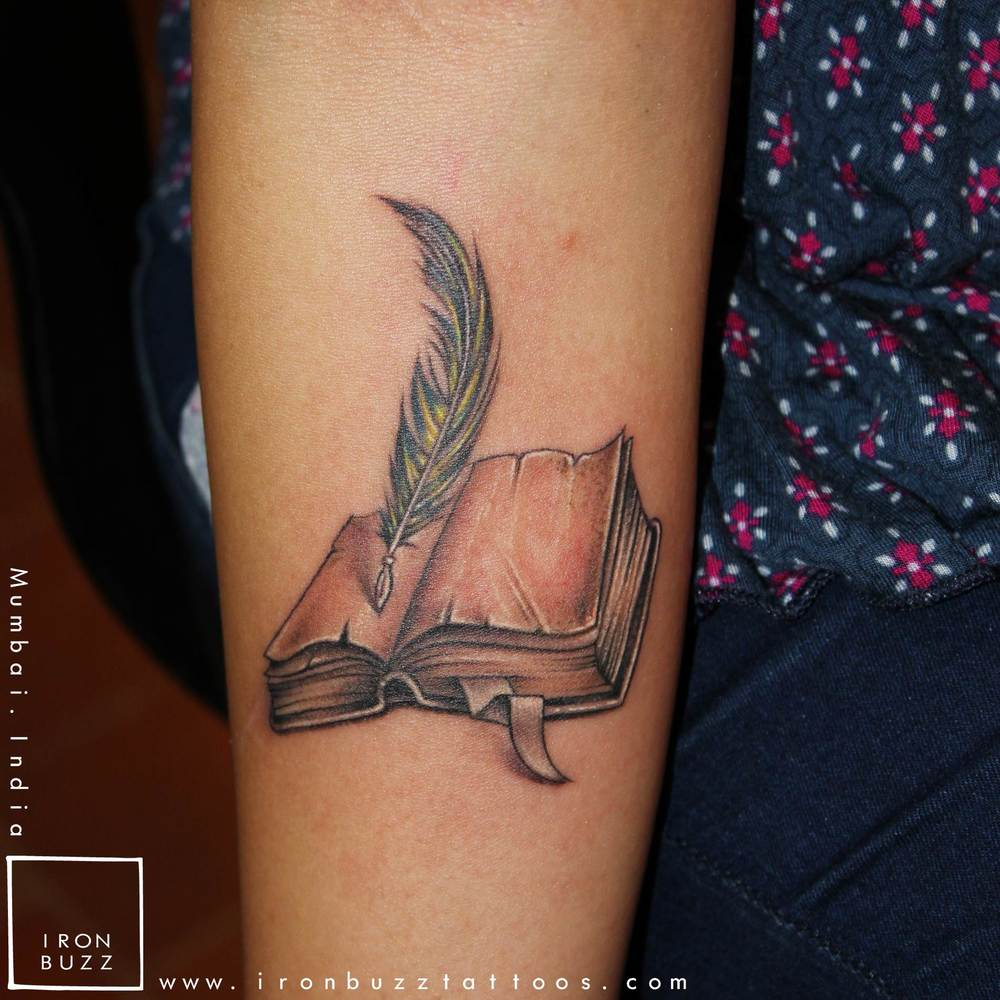 Medieval Book & Quill tattoo on forearm