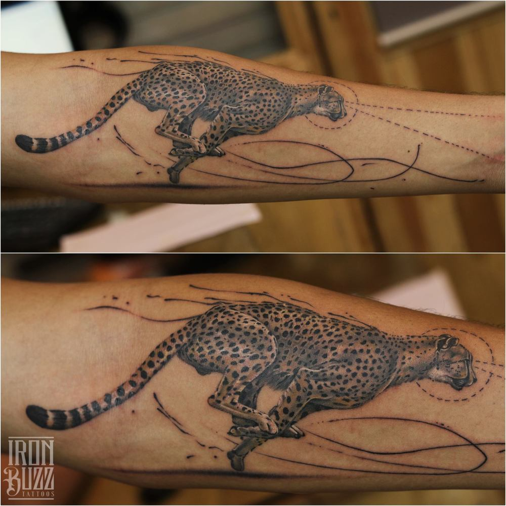Realistic Cheetah tattoo on arm
