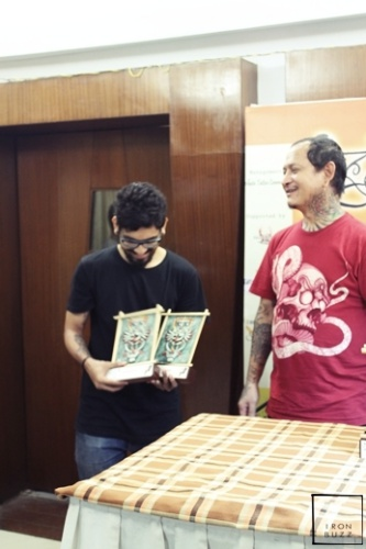 best-tattoo-artist-in-mumbai-india-eric-jason-dsouza-winning-best-black-and-grey-tattoo-award-at-international-kolkata-tattoo-convention-two.jpg
