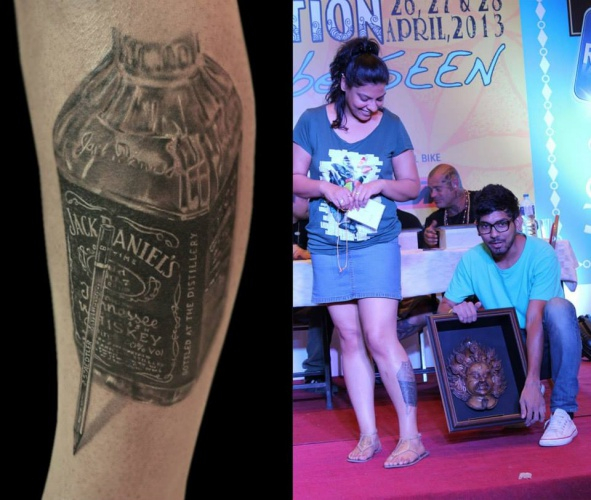 best-tattoo-artist-in-mumbai-india-eric-jason-dsouza-winning-best-black-and-grey-tattoo-awards-jack-daniels-whiskey-bottle-tattoo-at-international-nepal-tattoo-convention-two.jpg