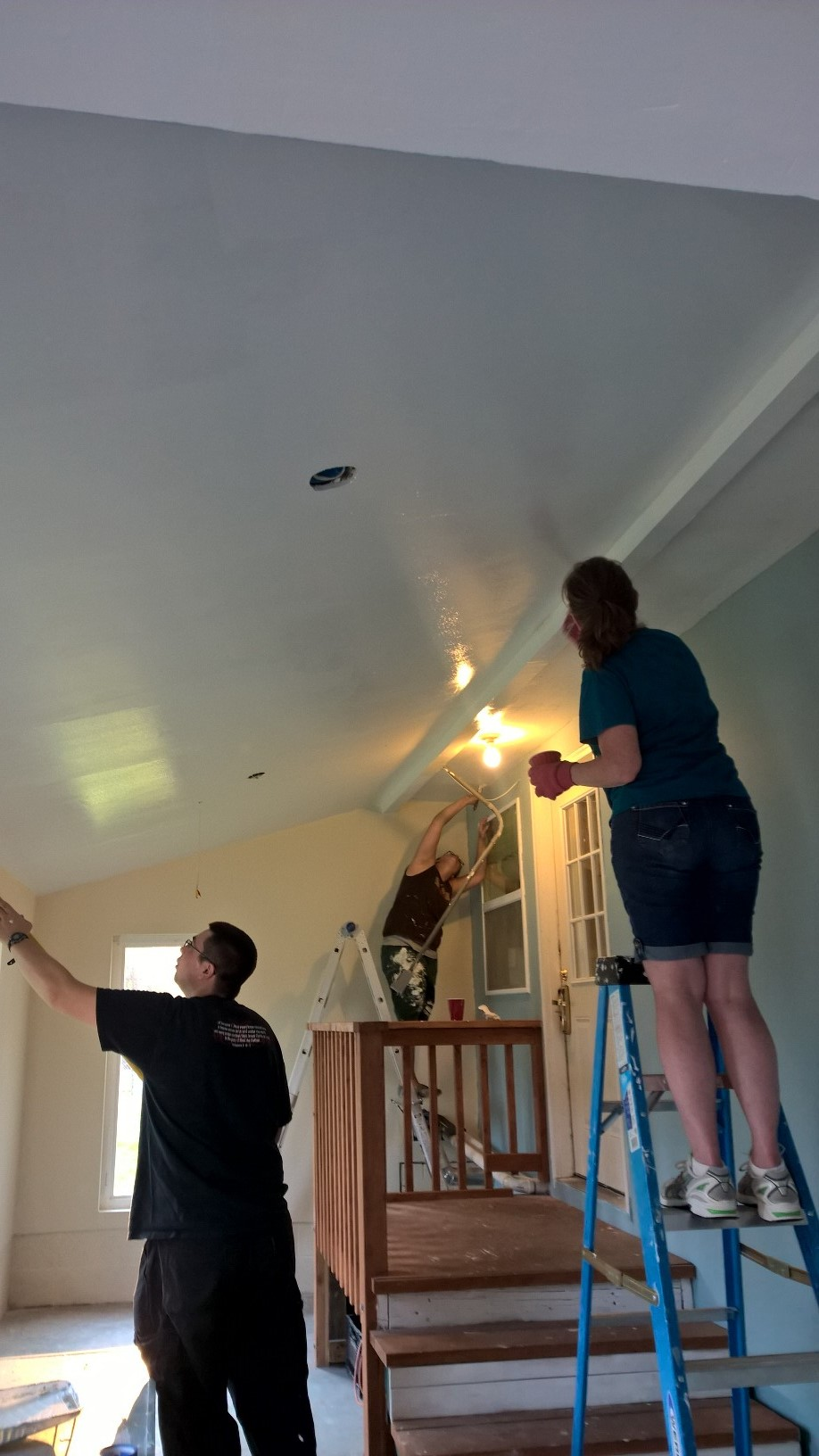 Volunteers from Crossover Church spent an Evening painting the ceiling and adding 2nd coats of paint