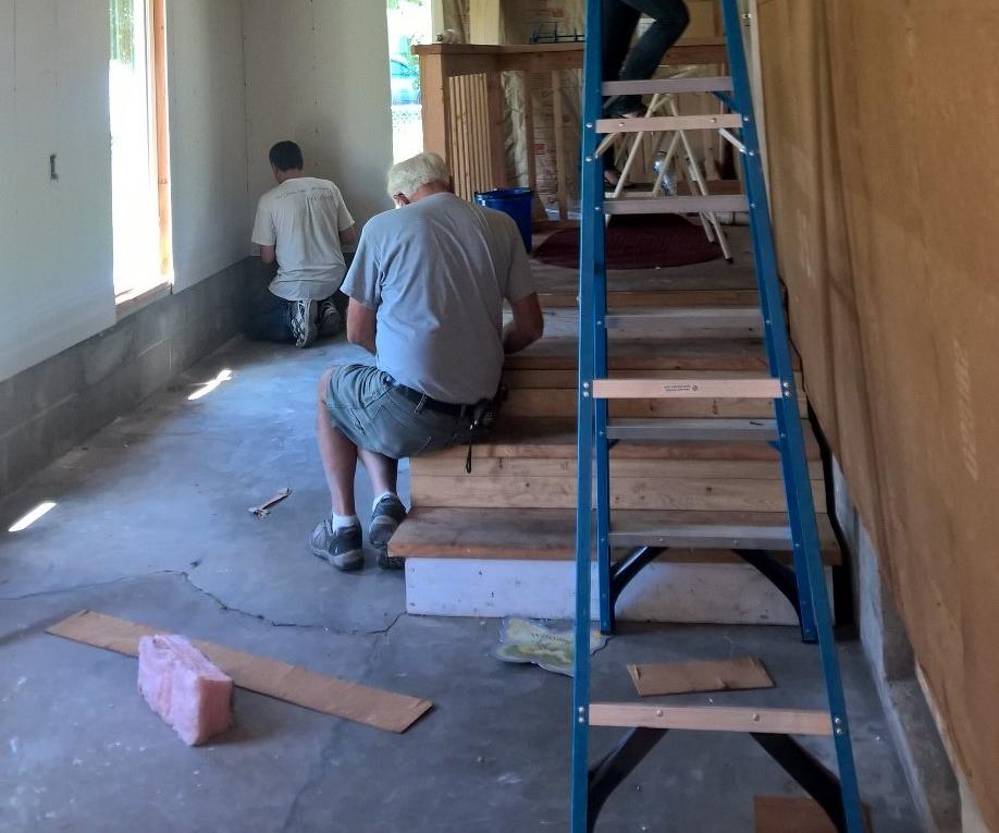 Daniel Installing Drywall for the Atrium