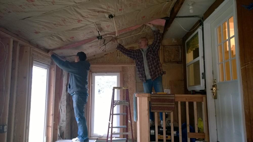 Daniel helping install Insulation