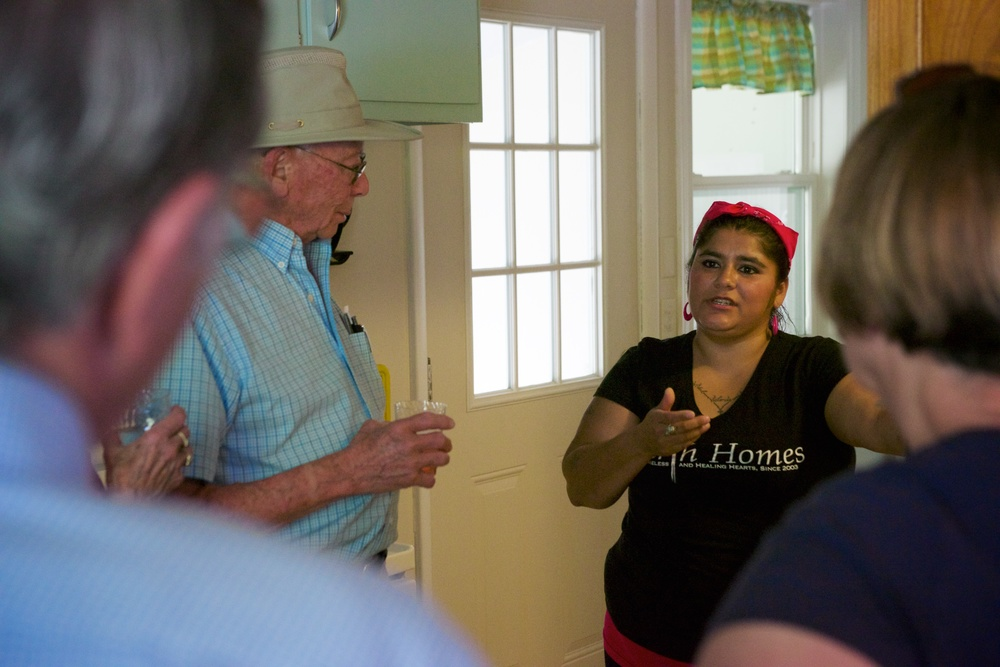 A Hearth Homes resident gives a tour to community members at our open house.