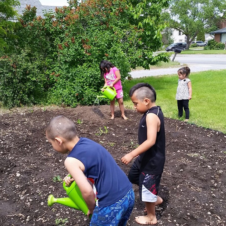 Hearth Homes kiddos plant their pumpkin patch with much anticipation!