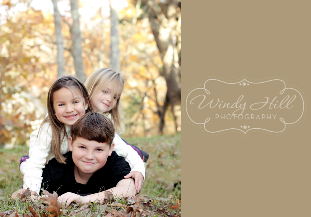 Maine Family Photographer three kids pigpile fall leaves.jpg
