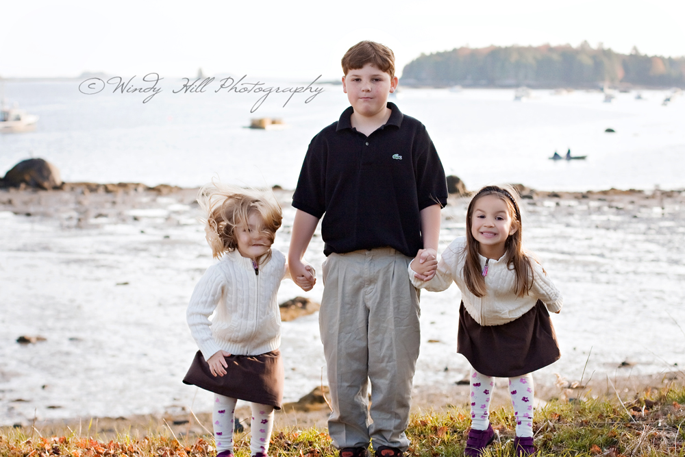 Maine Family Photographer brother and sisters on the seashore .jpg