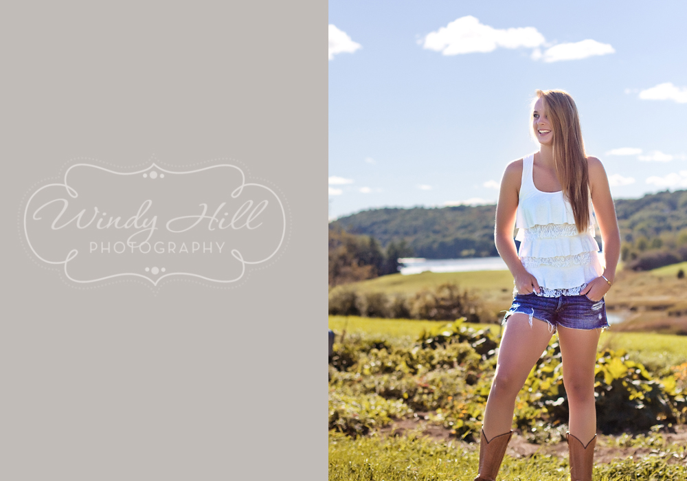 Maine Senior Photographer over field blue sky girl standing.jpg