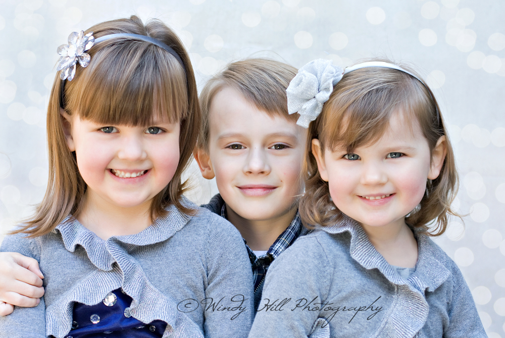 Maine Family Photographer twinkle session brother and sisters.jpg