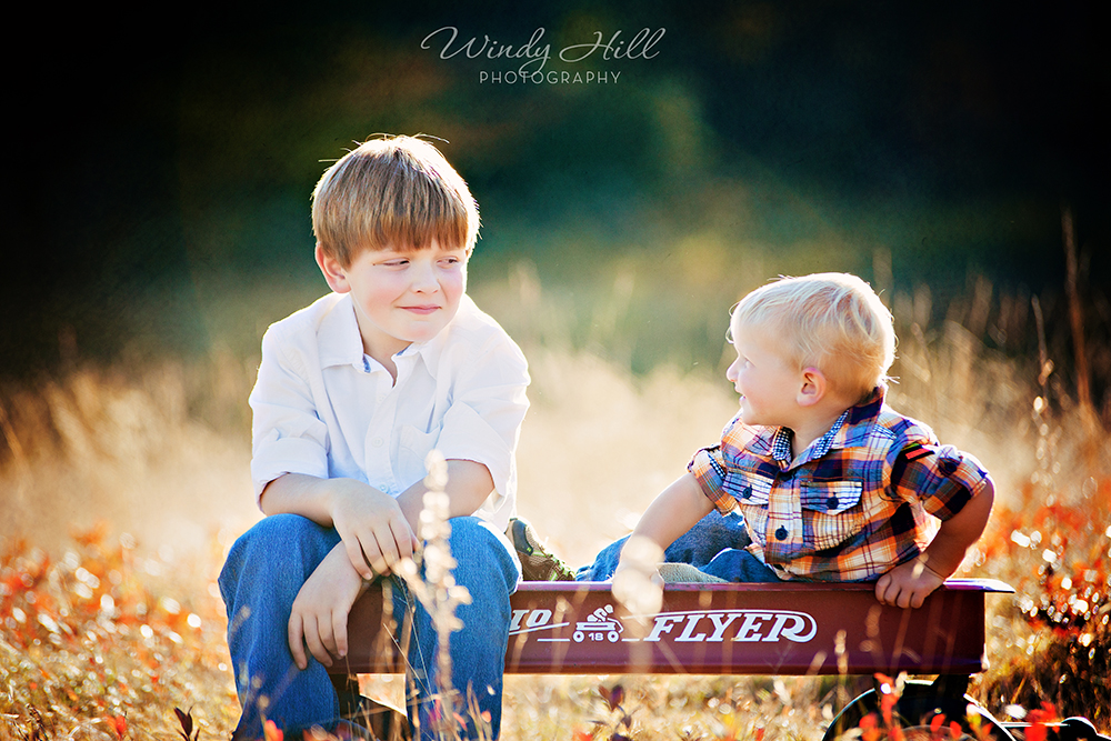 Maine Family Photographer brothers radio flyer pose funny faces.jpg