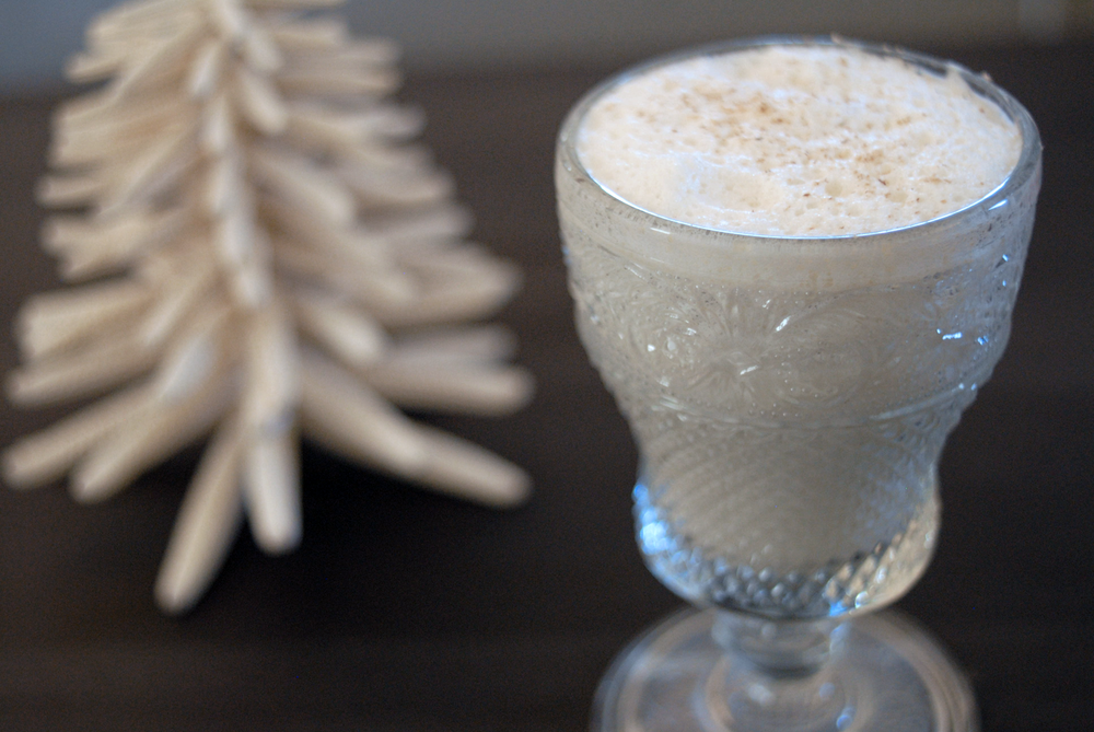 glass-of-eggnog-with-white-christmas-tree-docoration.png