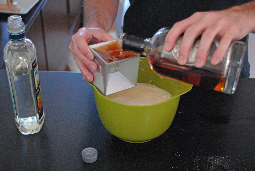 pouring-bourbon-into-eggnog-bowl.png