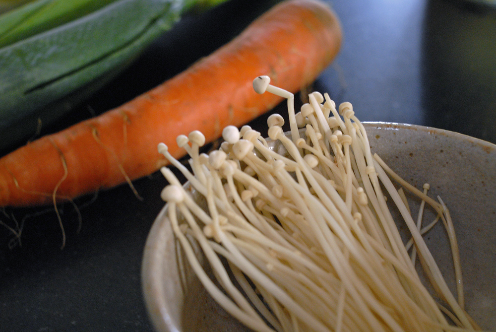 closeup-of-mushrooms-with-carrots-and-negi-in-the-background.png