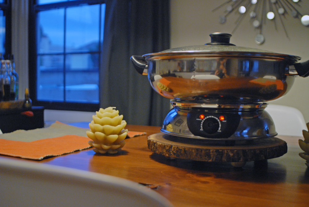medium-shot-of-shabu-pot-in-table.png