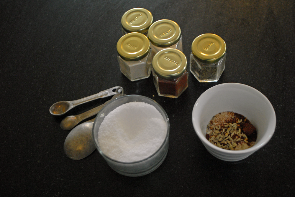 homemade-suasage-spice-mixture-with-salt-well-and-spice-bottles.png