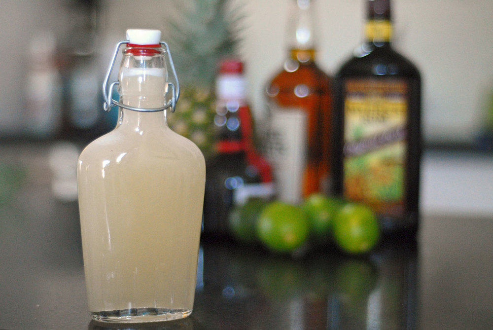 orgeat syrup in front of mai tai ingredients