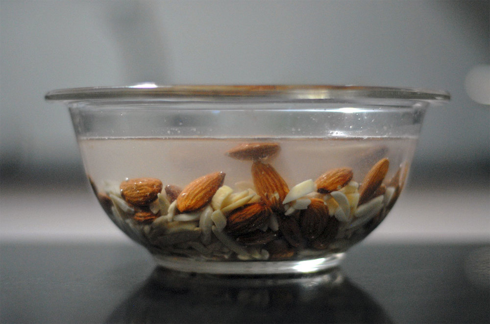 bowl of almonds for homemade orgeat covered in water