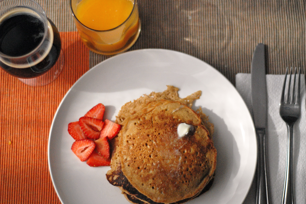 imperial-stout-pancakes-with-orange-juice-and-glass-of-stout-shot-from-directly-above.png
