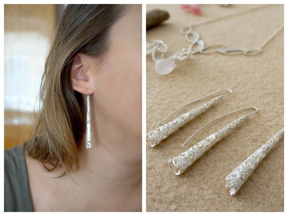 (these earrings and necklaces were created using dentelle that Ana saved from one her grandmother's scarfs and then created this collection using the same pattern)