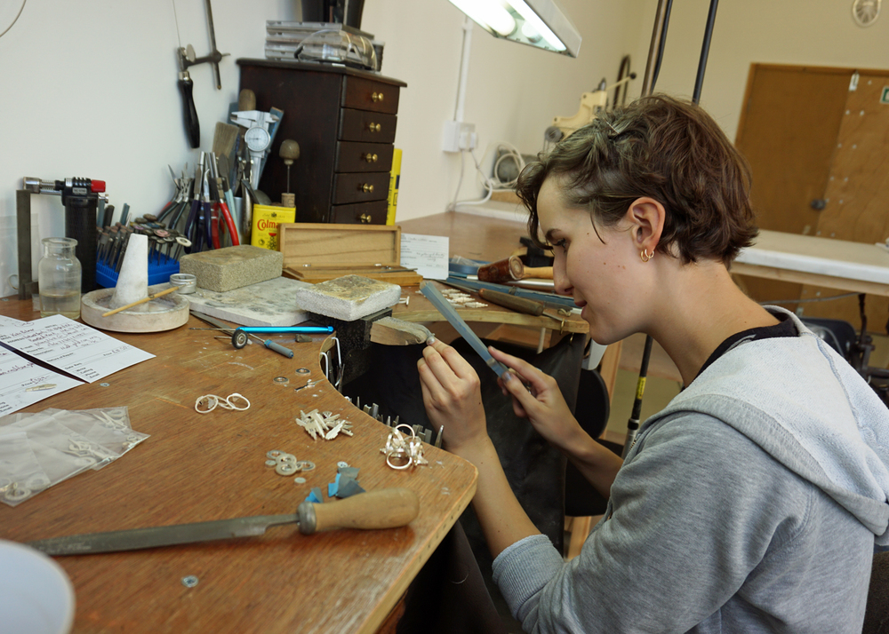 Clarice working at her bench