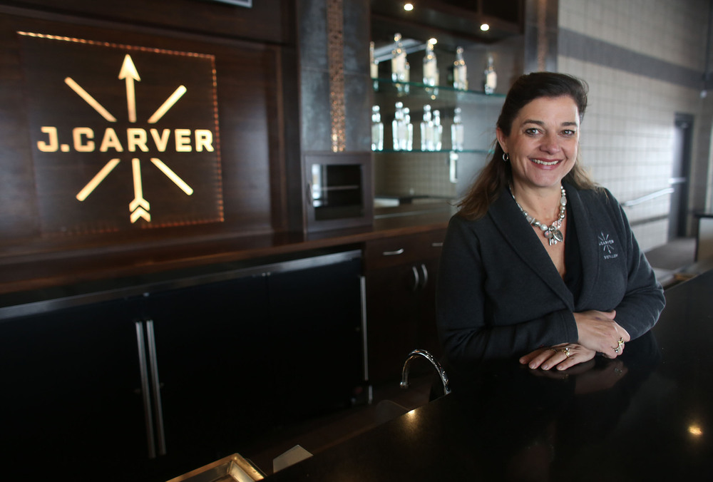 Gina Holman, of J. Carver distillery, stood behind the bar in the event space where they will have tastings. Photo: Kyndell Harkness, Star Tribune
