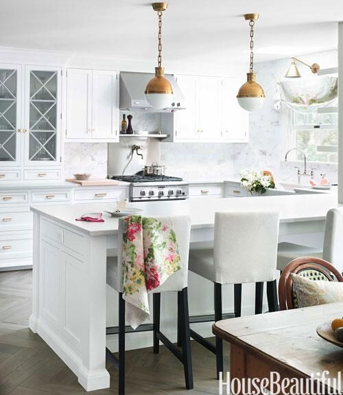 "Love that the simple floral towel sets off the ""springyness"" of this kitchen.."