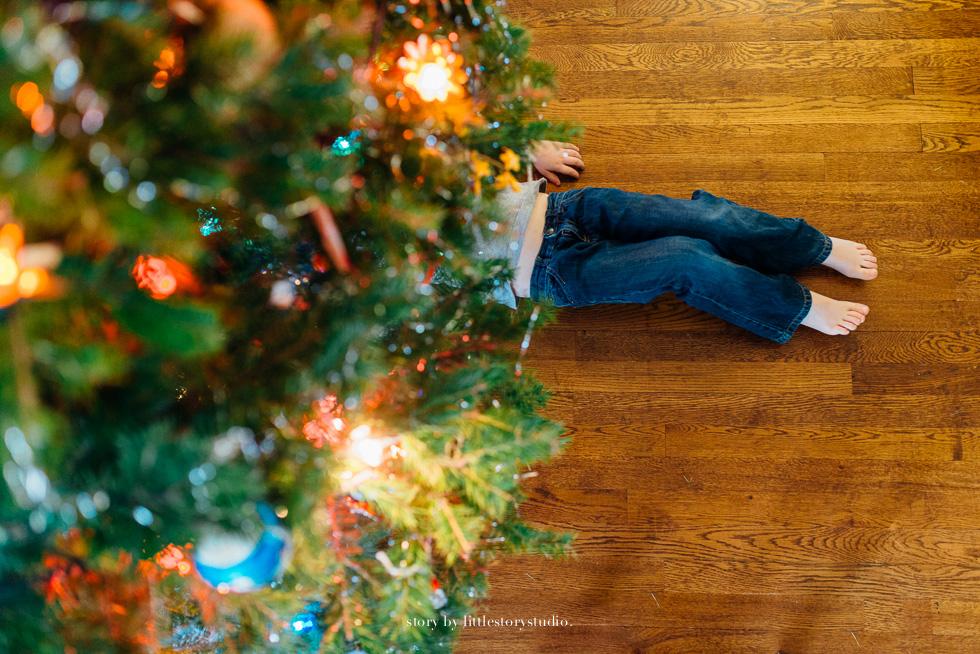 child-laying-under-christmas-tree.jpg