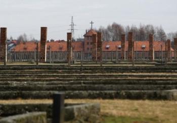 cross overlooking AUSCHWITZ dormatories