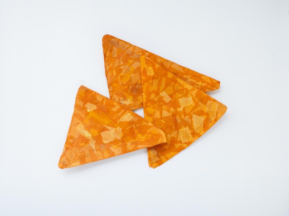 "Doritos, Nacho Cheese. 2015. cardboard, paper, glue. 36""x 36""  Photo:  Mikayla Whitmore"