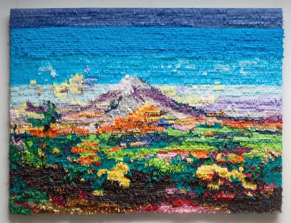 "Popocatepetl e Iztaccihuatl vistos desde Atlixco, after Jose Maria Velasco.  2016. Paper and glue. 64""x 82""  Photo:  Mikayla Whitmore"