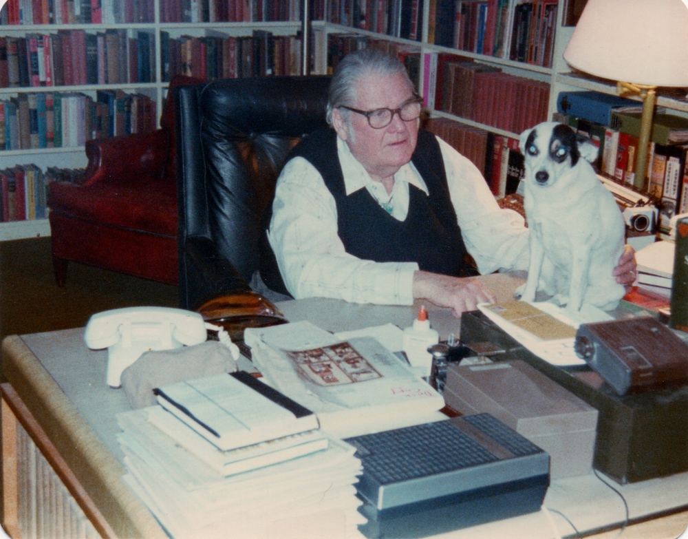 John and a small part of his library in his Santa Fe home in 1979. Photo by the late Charles E. Henry, BSI.