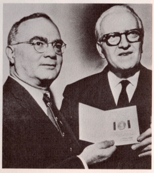 A photo of Julian Wolff giving Starrett his two-shilling award. Taken from The Last Bookman, edited by Peter Ruber.