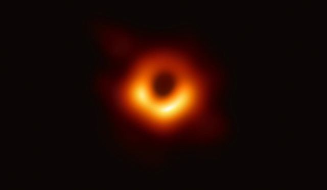 First ever image of a #blackhole taken by @ehtelescope it's at the center of #M87 and is 6.5b times the mass of our #sun - that isn't the event horizon you're seeing, that is actually much further in the center, but it's the shadow of the #singularity and the light you're seeing is being bent around the black hole. Brighter color is light moving towards us as it orbits.