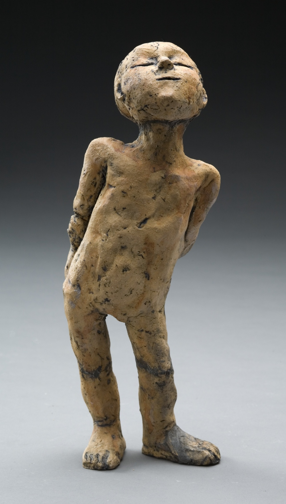Boy sculpture looking up.jpg