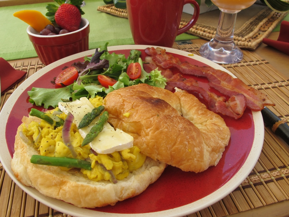 Egg Scramble with French Brie Baby Asparagus Red Onion on a Toasted French Croissant