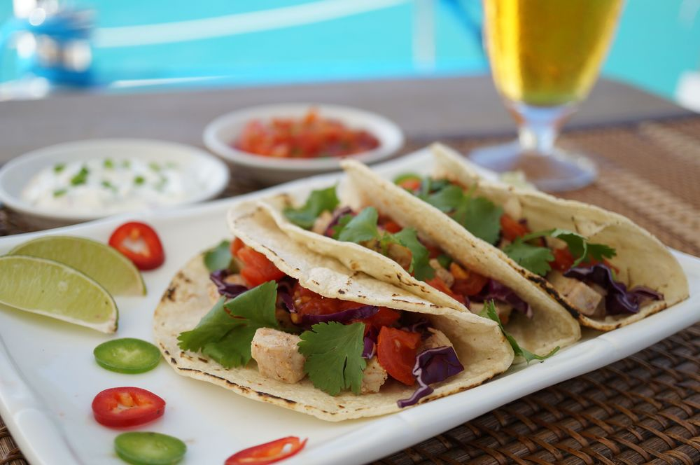Fish Tacos with Jalapeño Lime Sour Cream Sauce served