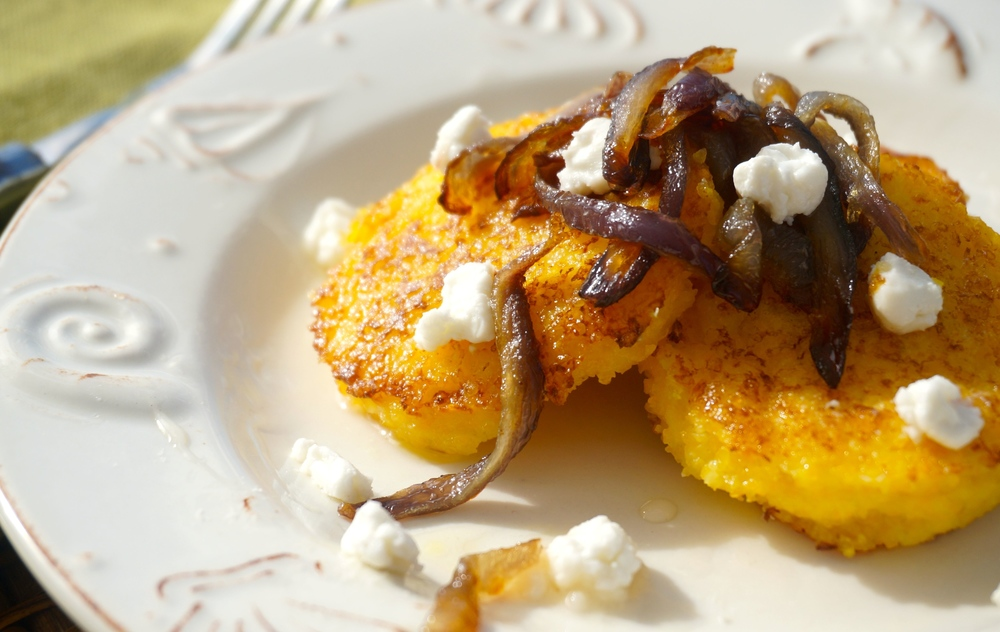 Griddled Polenta Cakes with Caramelized Onions Goat Cheese and Honey Drizzle