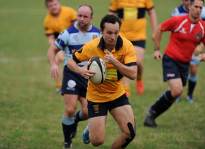 Bursting away.  Seb Goodhuw scored Oaks last try. Photo Credit: David Purday