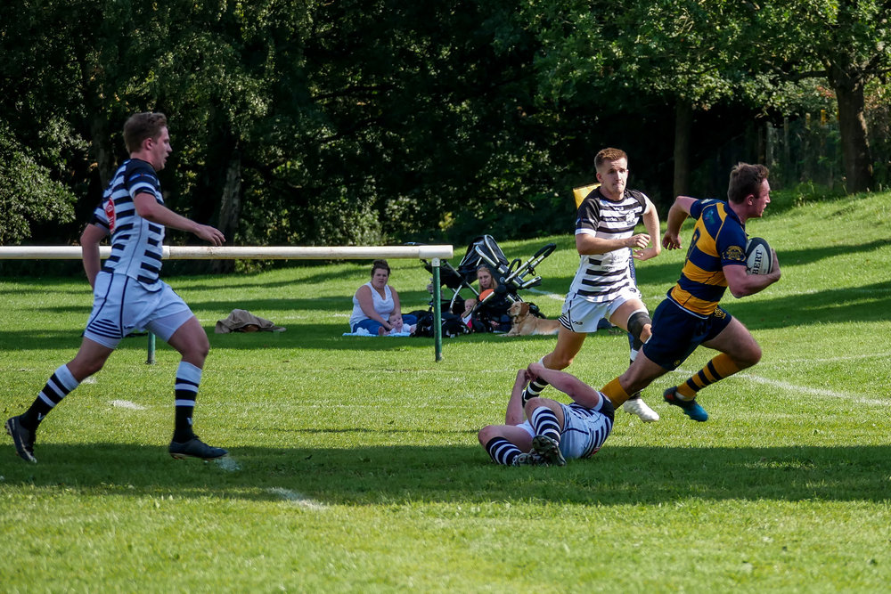 Oaks scrum half Matt Holmes breaks through a Thurrock tackle to score the opening try for Oaks.  Photo Credit: Wes Filtness