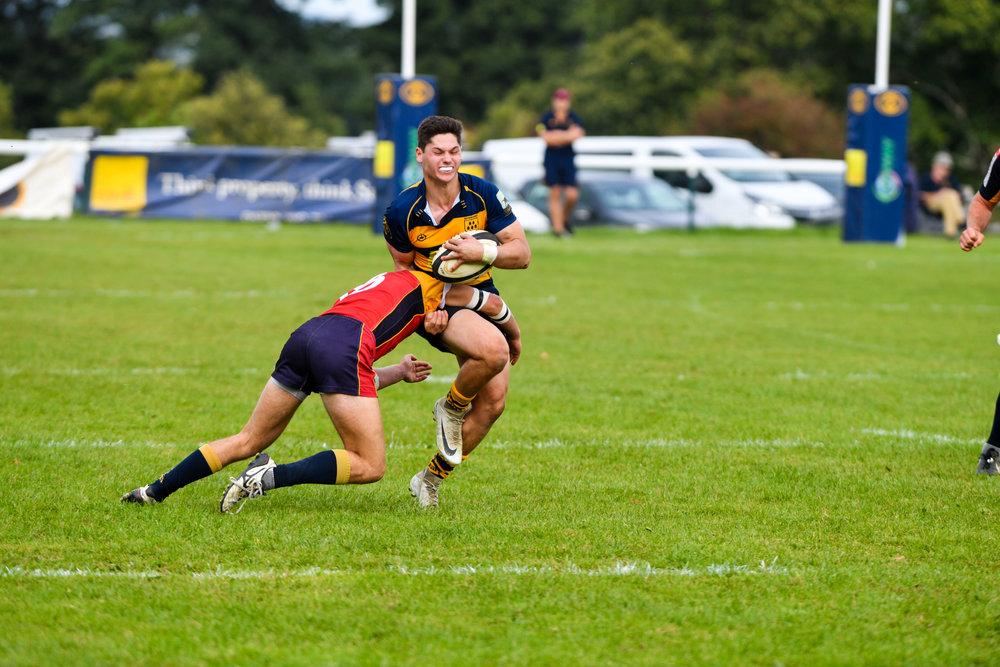 Oaks Leighton Ralph looks to burst through in Oaks last home match to Chobham.  Photo credit: David Purday