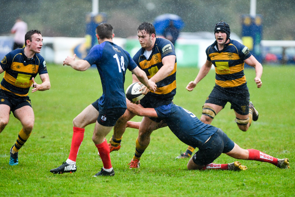 Oaks back rower Ben Golds looks to offload the ball in torrid conditions at the Paddock. Photo Credit: David Purday