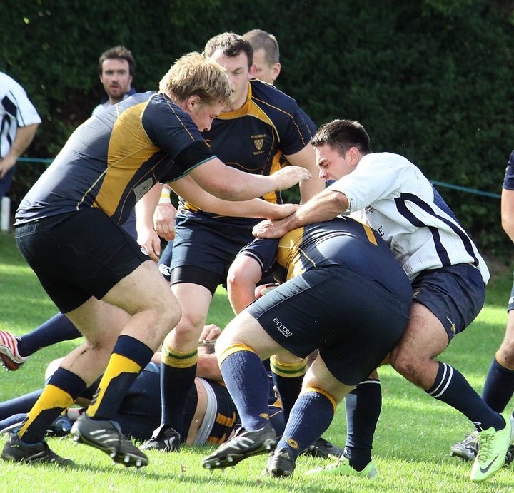 In the thick of it from day 1!  A young blonde haired Naismith goes to help out his prop partner David Jones during his debut against Dunstonians.  Photo Credit: Lee Adamson