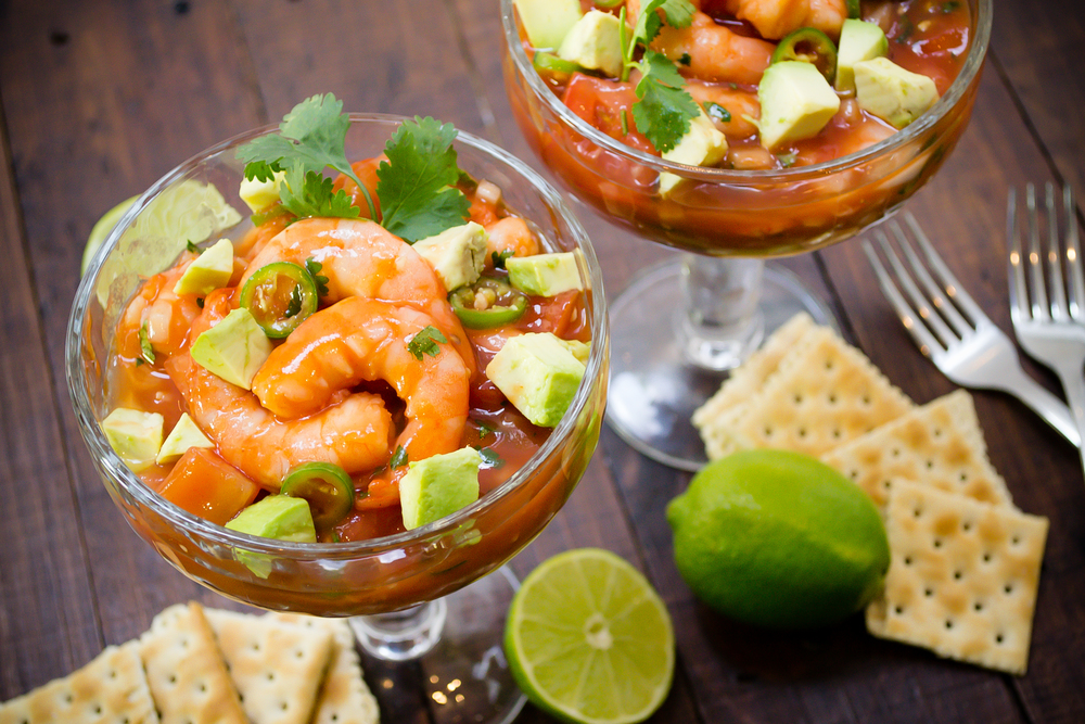 Mexican shrimp cocktail marinated with tomato sauce, lime juice, onion and coriander served with avocado and crackers.