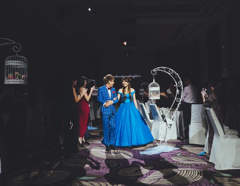 For a banquet dinner stunner, our bride, Zhixin sported a two-piece Cinderella-inspired ballgown specially tailored to her height and comfort. Photo by Multifolds Photography.