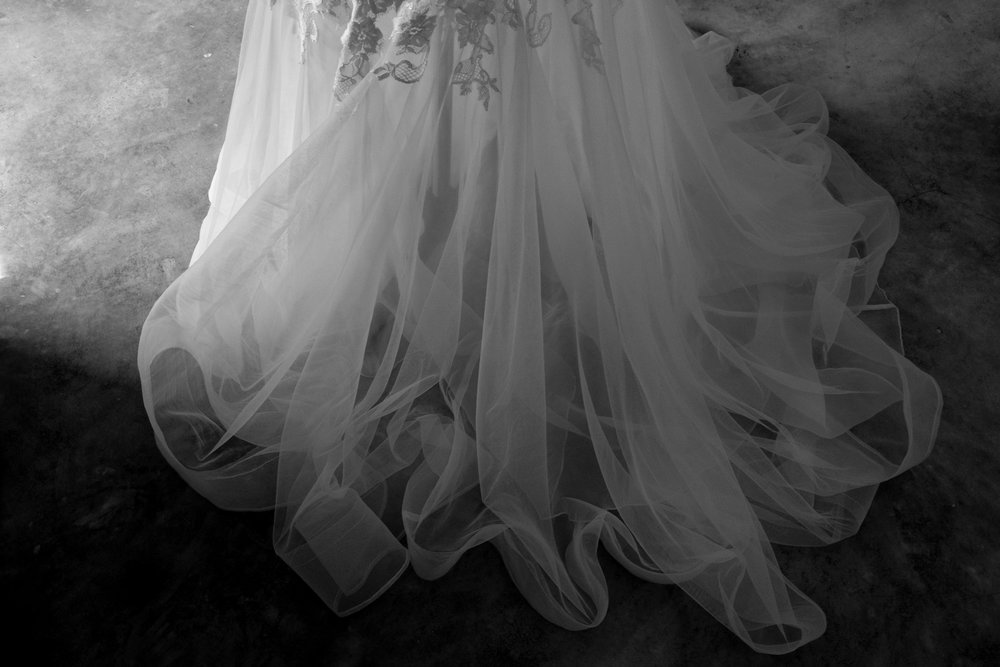 We work with our brides to craft the perfect gown for you. Featured here is a semi-translucent tulle train for the added drama as you walk down the aisle.