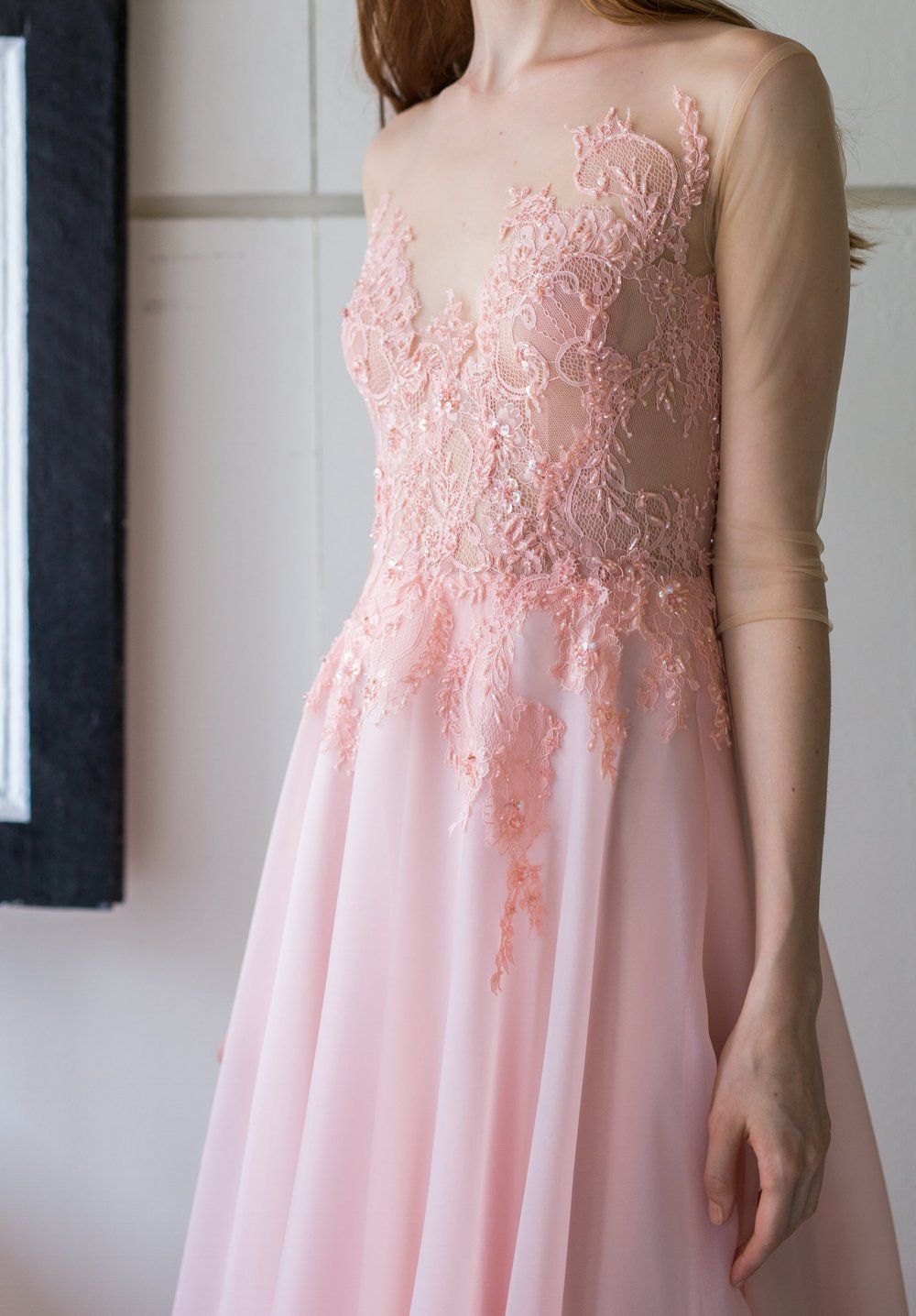 An illusion lace-top dress lined with Chantilly lace and layered with coral monochrome beads.