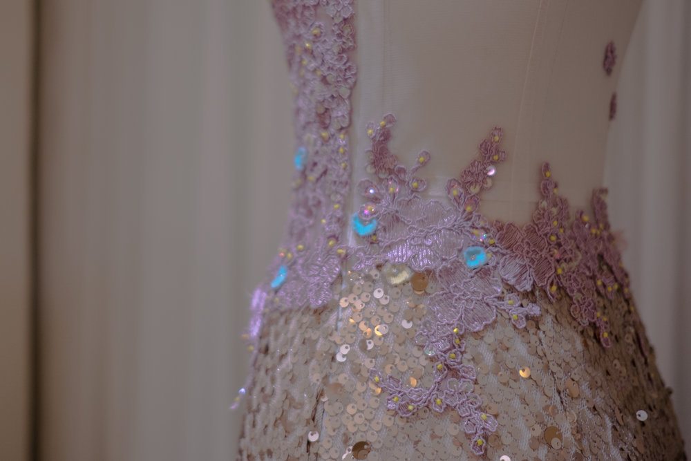 A sequined mermaid gown with corded lilac lace, brought to life with scattered yellow beads.
