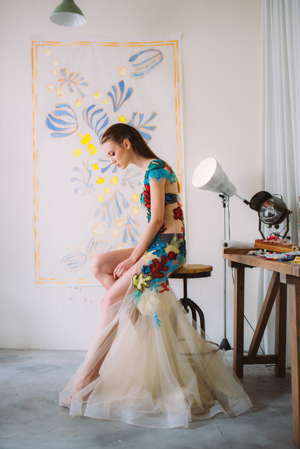 "- We just can't shy away from detail works can we? Cut- outs and hand embroidery that gives a bold artistic look to the style. Amanda's latest iconic design gives nod to what we perceive as ""wearable art"" as some of you may have seen in our styled shoot here."